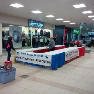 Volunteers set up the SPDCPA Christmas Gift Wrap tables at the Dawson Mall December 14, 2014. Gift Wrapping fundraiser runs December 14 to 24.